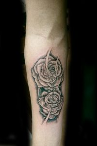roses on forearm