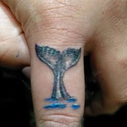 whale tail finger tattoo by Dana