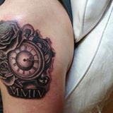 clock tattoo by Dana