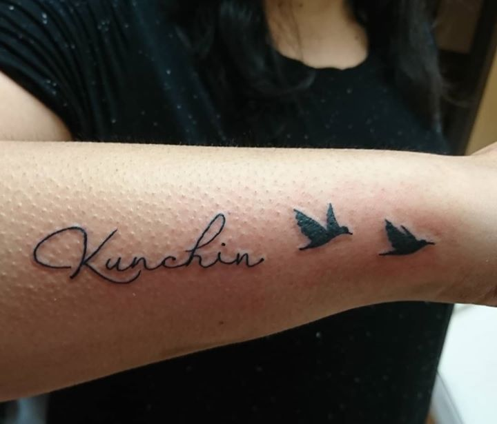 script and flying bird tattoo by Dana