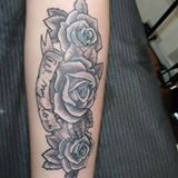rose and script forearm tattoo