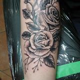 Blacky & Grey roses on forearm #langleytattoo