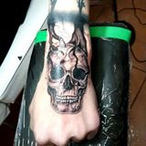 skull hand tattoo - revolution ink tattoo